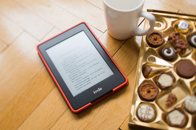 Amazon Kindle with coffee cup and chocolates