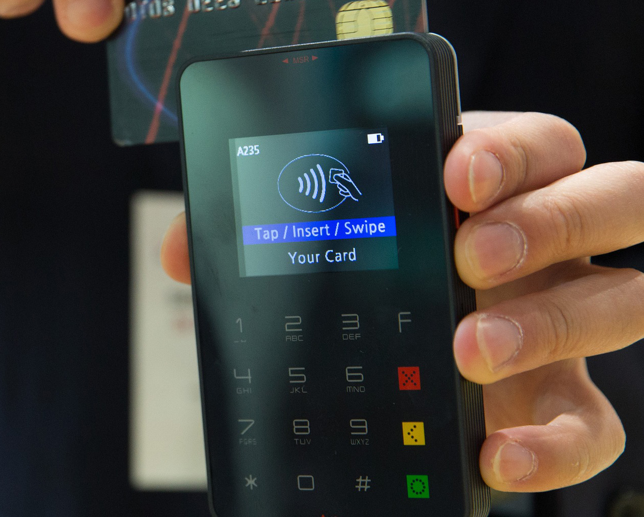 Person using contactless payment method