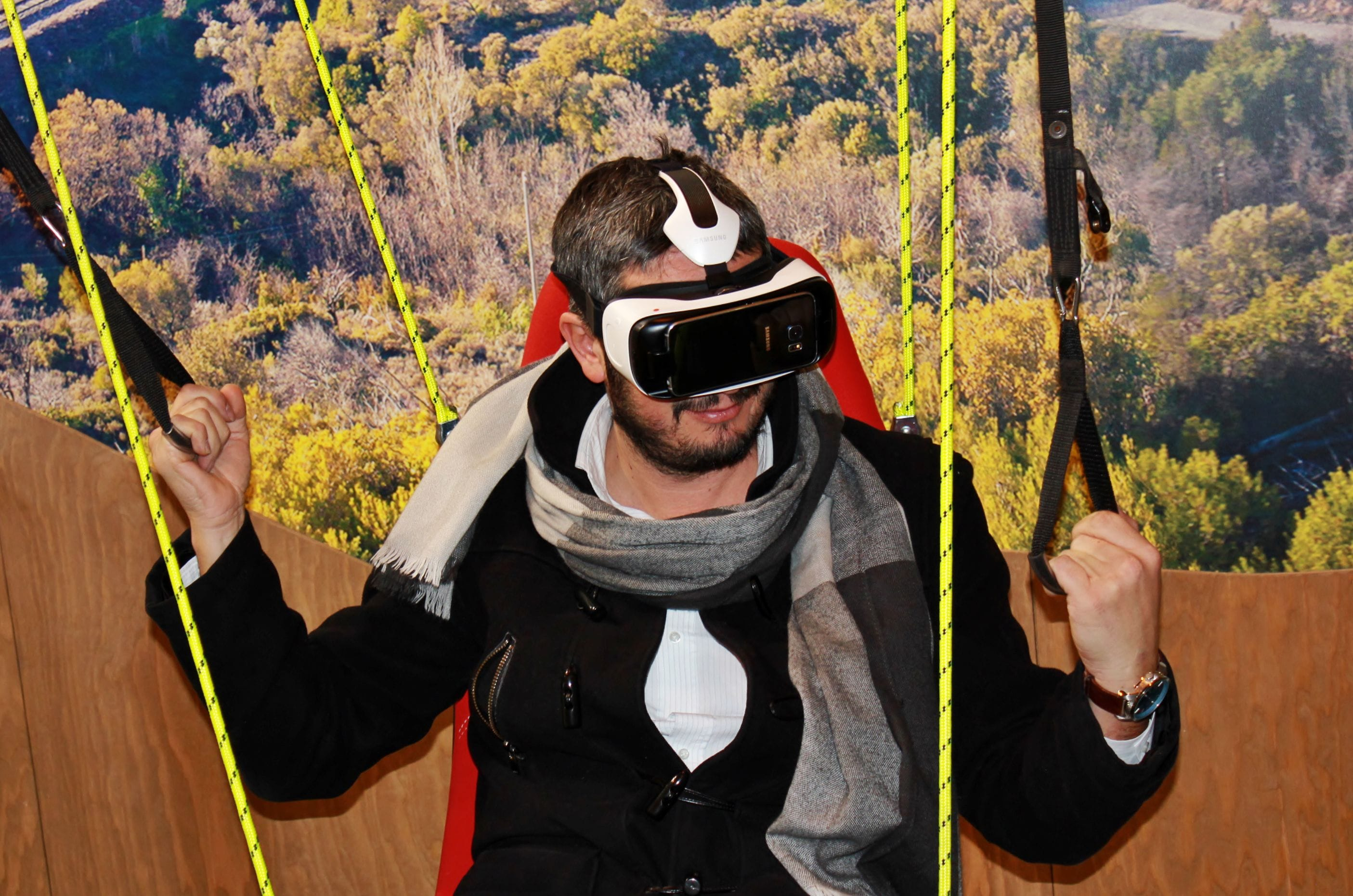 man wearing VR glasses with a countryside background