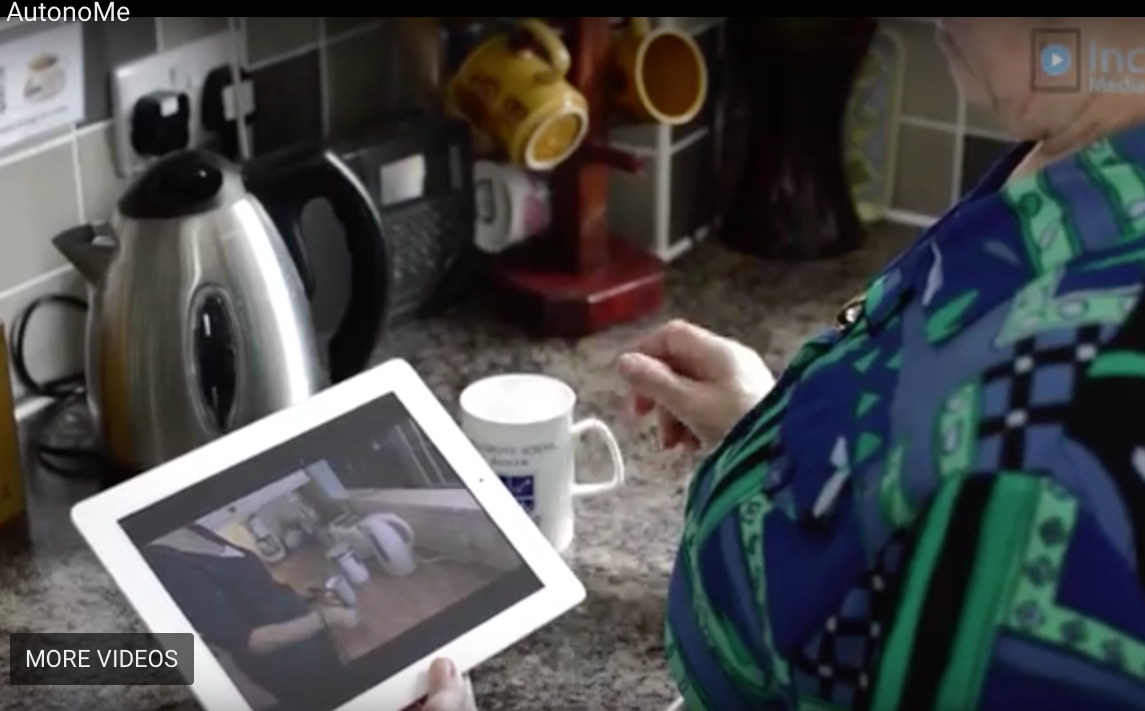 a lady uses autonome in her kitchen to learn how to use her kettle