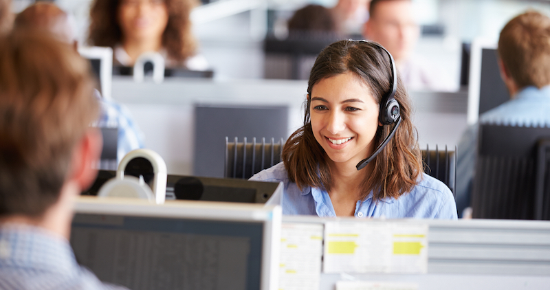 woman in call centre with bluetooth headset
