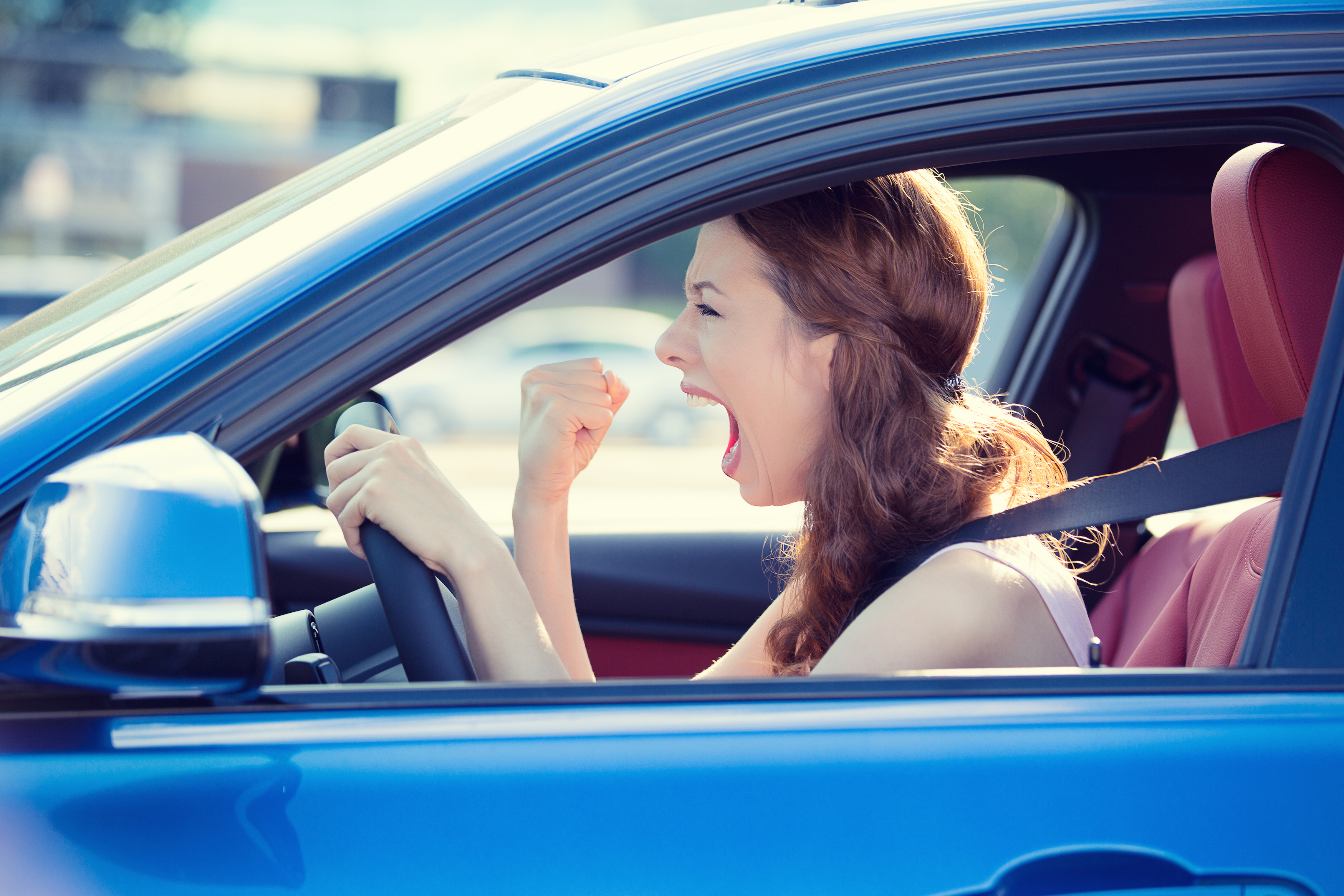 woman in car looking like she has road rage