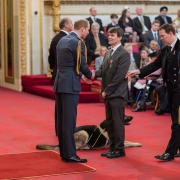 Image of Robin Christopherson receiving his MBE from The Duke of Cambridge