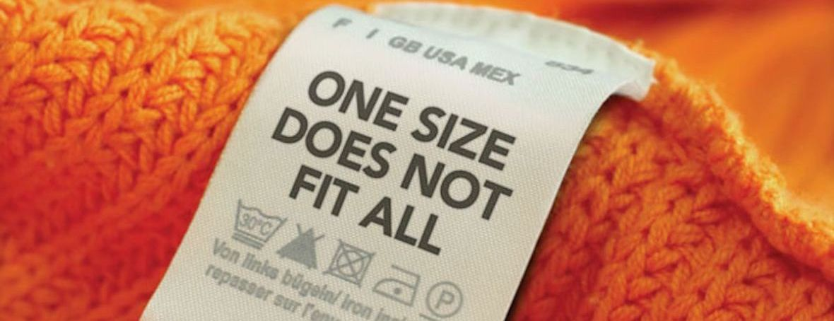 A garment label with text that reads 'one size does not fit all'