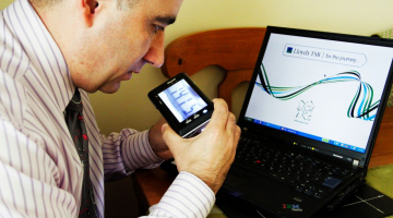 Aslam Lloyds Banking Group uses a portable magnifier