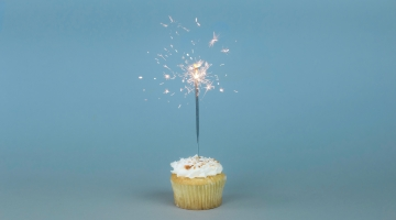 A cupcake with a sparkler in it