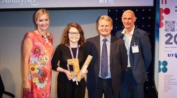 Kiera pictured with BBC's Kate Rusell holding award