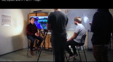 a screen grab of Hugo being filmed at university for the video