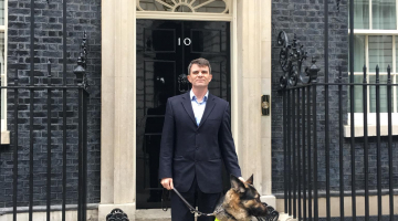 Robin Christopherson and his guide dog Archie outside number 10